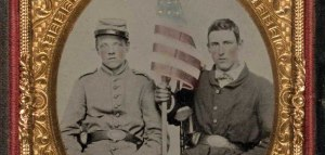 Two soldiers seated with American flag, ca. 1862